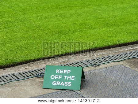 London,the UK-May 2016:Keep off the grass notice at tennis  courts