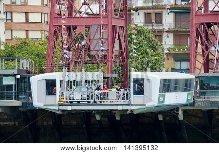 GETXO, near BILBAO. 27th July 2016. A close-up view of the capsule under the Viscaya transporter bridge. The bridge has been a huge tourist draw to the Getxo suburb of Bilbao.