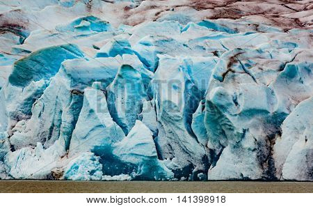 Juneau AK USA Closeup view of the moraine and blue ice of the Mendenhall Glacier ice caves and calving.