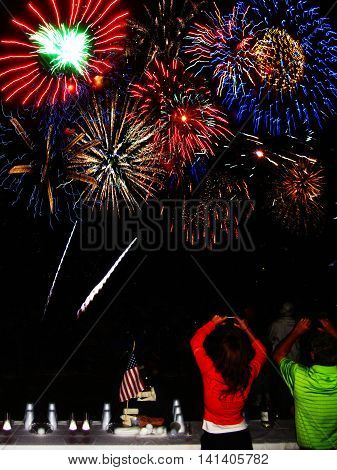 Fourth of July fireworks display being photographed