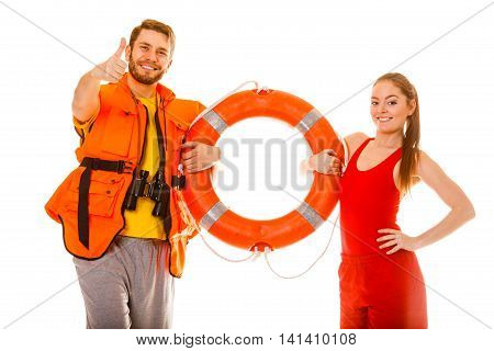 Lifeguards with ring buoy in life vest jacket. Man and woman supervising swimming pool showing thumb up gesture. Accident prevention.