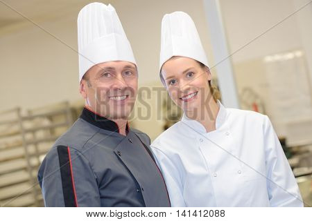 portrait of a chef with his commis chef