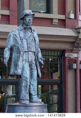 Vancouver Canada - July 24 2016: Bronze statue of Gassy Jack Jack Deighton the man who opened the first saloon in the Gastown district which is the first established neighborhood of Vancouver.