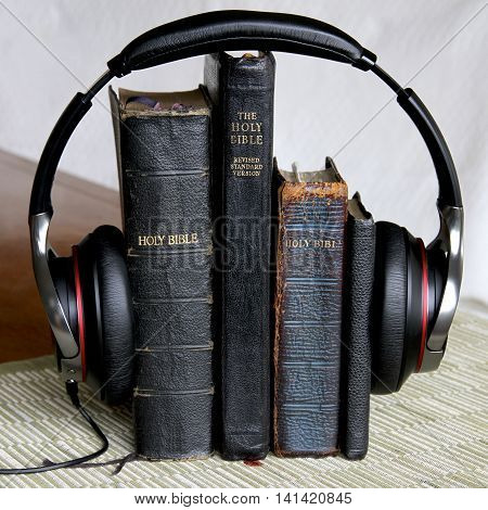 Some old holy bibles and headphones listening.