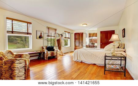 Elegant Woman Bedroom Interior With Dressing Mirror And Sitting Space
