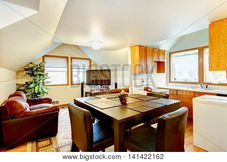 Dining And Kitchen Room Interior With White Vaulted Ceiling.
