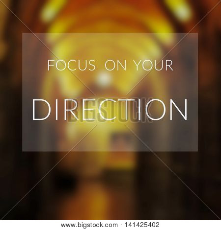 Inspirational quote on blurred background...Focus on your direction