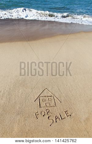 Beach House for Sale concept. Vertical on sand with breaking wave.