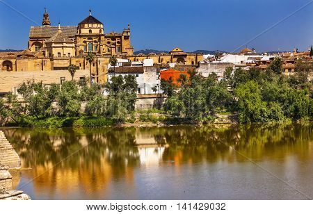 Torre del Alminar Bell Tower Mezquita Guadalquivir River Cordoba Andalusia Spain. Mezquita created in 785 as a Mosque was converted to a Cathedral in the 1500.