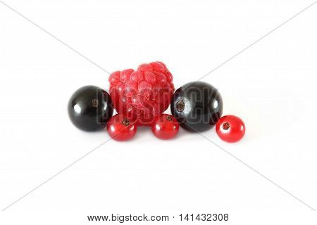 Various fresh fruits berries (raspberries black currants red currants) isolated on white background