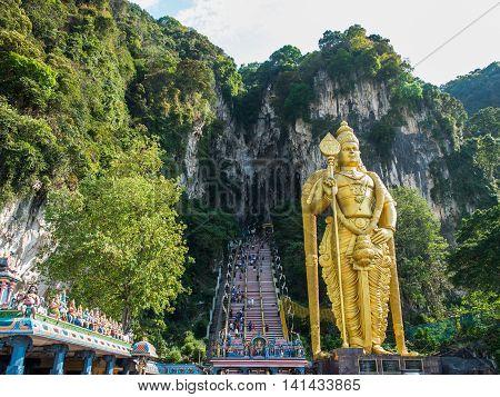 Kuala Lumpur, Malaysia - Mar 1: Tourist And Lord Murugan Statue In Front The Batu Cave Entrance