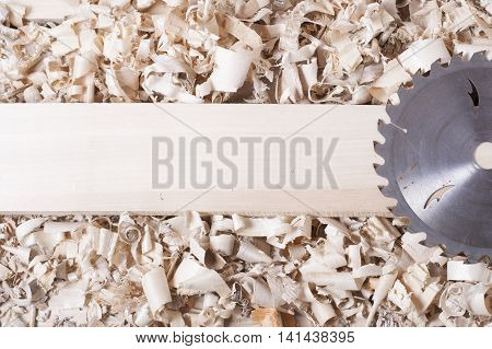 Construction tools on wooden table with sawdust. Joiner carpenter workplace top view poster