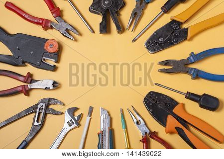 Set of electrical tool on wooden background. Accessories for engineering work, energy concept poster