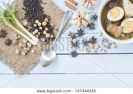 Thai food Kai-Pa-lo with spices on wooden sky blue background.12