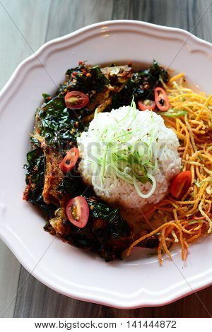 Indonesian rice style with fried pasta and vegetable on white plate