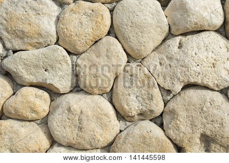 yelow and lite oval stones in the wall like background