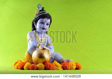 Hindu God Krishna on green background. Greeting