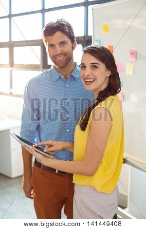 Business executive and co-worker using digital tablet