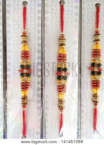 Indian rakhi threads packed for purchase. The festival symbolizes the brother sister love and the brother's protection of his sister