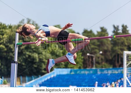 young woman in highjump track and field