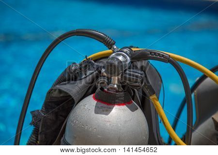 Diving equipment in front of water detailed view