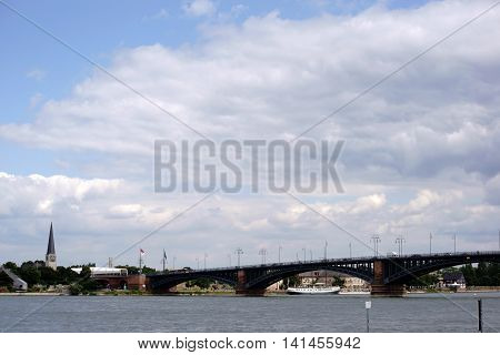 The Theodor Heuss Bridge in Mainz on the river Rhine and the banks in Mainz-Kastel with the St. George's Church in the background.