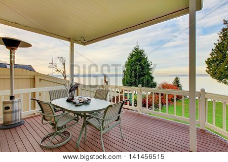 Awesome Water View From The Wooden Deck With Patio Table