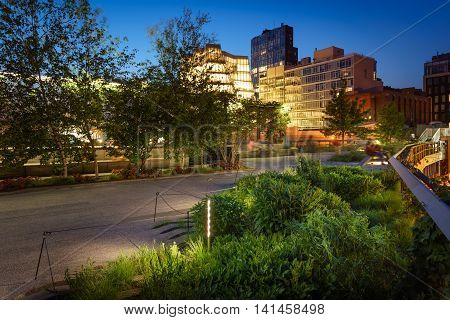 The Highline at twilight in summer. The aerial green-way also called High Line or High Line Park is an oasis in the heart of Chelsea, Manhattan, New York City.