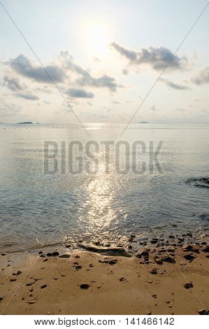 Beach with tranquil seascape during sunrise in dawn at Ao Lung Dam beach in Samet island Thailand.