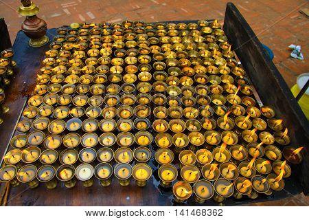 Candles at Boudhanath Stupa in Kathmandu, Asia