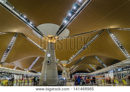 Kuala Lumpur, Malaysia - circa August 2016: passengers at check-in counter inside Kuala Lumpur international airport. Kuala Lumpur international airport is the biggest airport in Malaysia and is a major airport in Asia.