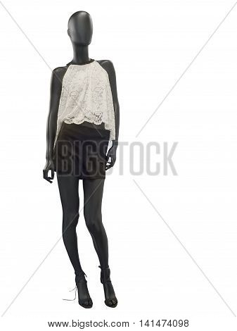 Female mannequin dressed in shorts and sleeveless lacy top isolated on white background.