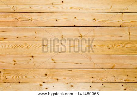 Plain clean natural wooden boards or panel background texture in an overhead full frame view