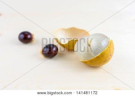 closeup longan tropical fruit on a wooden plank
