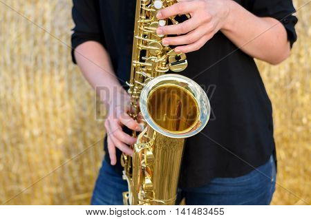 Close Up On A Shiny Brass Tenor Saxophone