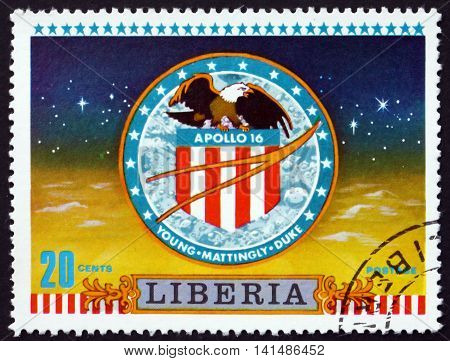 LIBERIA - CIRCA 1972: a stamp printed in the Liberia shows Apollo 16 Badge Moon Landing circa 1972