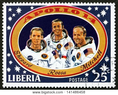 LIBERIA - CIRCA 1971: a stamp printed in the Liberia shows Shepard Roosa and Mitchell Apollo 14 Moon Landing circa 1971