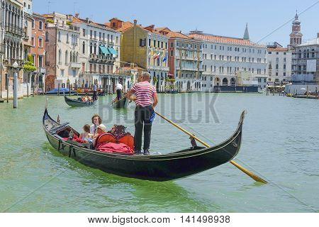 Venice, Italy, June, 21, 2016: gondola sails down the channel in Venice, Italy. Gondola is a traditional transport in Venice, Italy