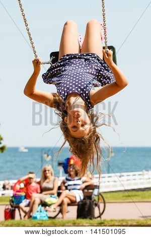 Playful Crazy Girl On Swing.