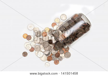 A pot fell and drop off a lot of coins