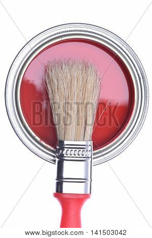 Top view of red paint can with brush isolated on white background