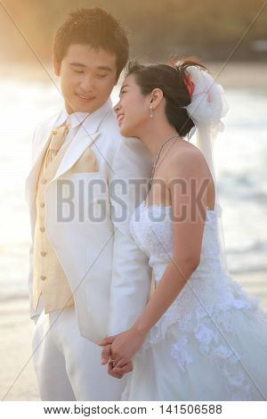 asian man and woman in wedding suit ceremony happy emotion at sea beach romance emotion