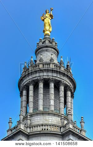 New York City - June 29, 2016: Civic Fame Statue on the Municipal Building in New York City a 40-story building built to accommodate increased governmental space demands after the 1898 consolidation of the city's five boroughs.