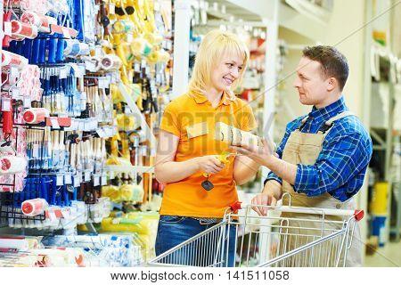 Hardwarer store worker with craftsman buyer