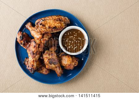 Teriyaki Chicken Wings With Sauce On Table Top