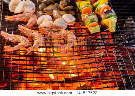 Barbecue Grill Cooking Shrimp Seafood.