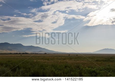 Steppe, Mountains And Clouds