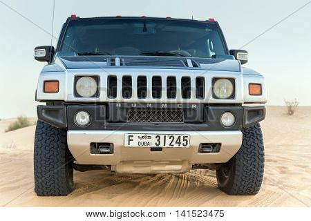 DUBAI UNITED ARAB EMIRATES - JANUARY 25 2016: Safari rally Hummer H2 off-road car 4x4 adventure driving in the desert sand dune is a popular activity among tourists in Dubai.