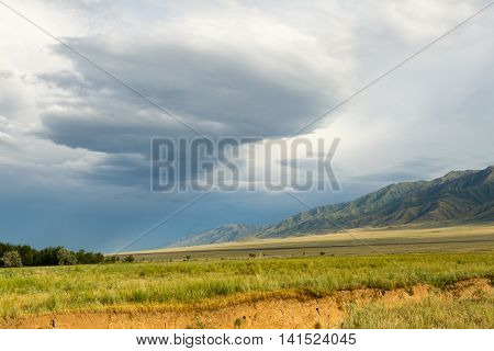 Steppes, Mountains And Storm Clouds