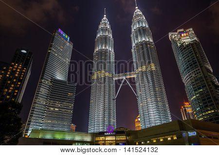 KUALA LUMPUR - FEBRUARY 19 2015: Petronas Twin Towers in Kuala Lumpur was illuminated with neon unlike the ordinary white color neon. Petronas Towers in night scene at Kuala Lumpur Malaysia